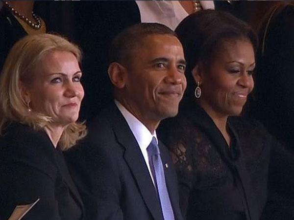 باراك اوباما وزوجته في جنازة مانديلا