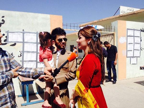 بالصور نجمة اراب ايدول برواس حسين تدلي بصوتها الانتخابات 2014-05-01_00119.jpg
