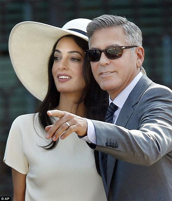 جورج كلوني وزوجته آمال علم الدين يقيمان حفل زفاف ثان بالمملكة المتحدة.. صور