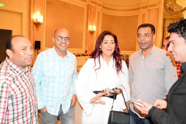 وفاء عامر وجمال العدل بحفل افطار شركة الشروق للأوراق المالية