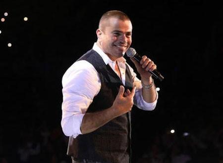 عمرو دياب يعلن عن تأجيل حفله الغنائي فى مصر