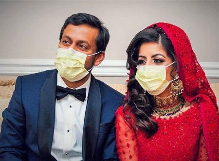 عروسان أمريكيان يقضيان شهر العسل في علاج مصابي كورونا